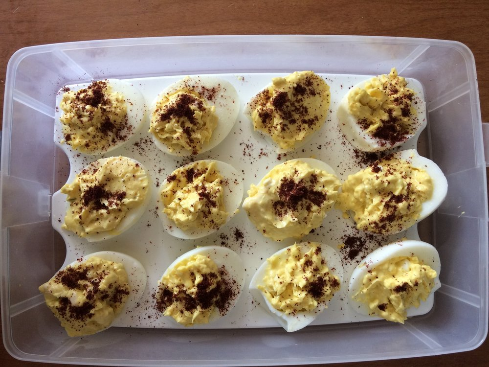 Yellow & white eggy goodness sprinkled with sumac. Deviled egg carrier is a must have for deviled egg mavens.