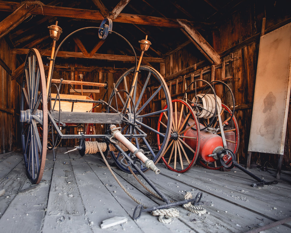 The horse drawn fire carriages.