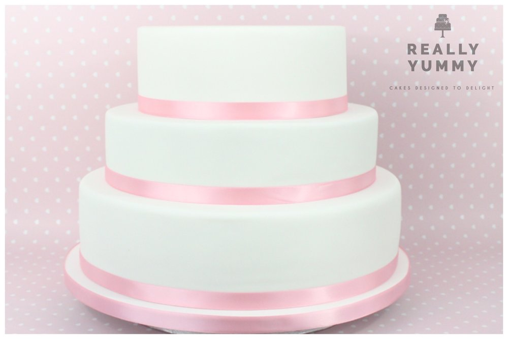 Wedding cake, with pink ribbon