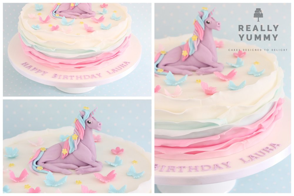 Unicorn cake with butterflies in pastel colours