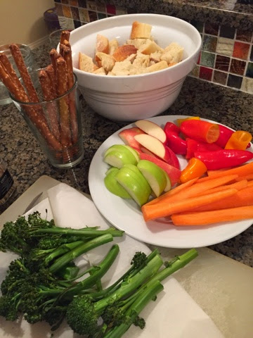 Our dippers: pretzel rods, french bread, apples, carrots, mini peppers, and roasted broccolini