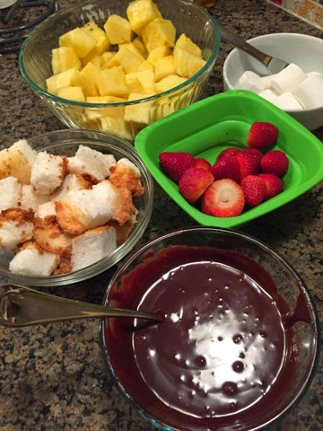 Chocolate dippers: Angel food cake cubes, marshmallows, strawberries, fresh pineapple. Not pictured: More pretzel rods...and Oreos. Yup.