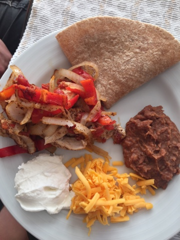 I served our fajitas with refried beans, some plain Greek yogurt standing in flawlessly for the sour cream I didn't have in my fridge, and some sharp cheddar. Great Friday night meal.