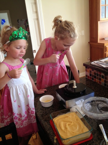My sous chefs tasting their work before we put the frozen yogurt in the freezer. What, you don't wear a St Patrick's Day crown year-round in the kitchen?