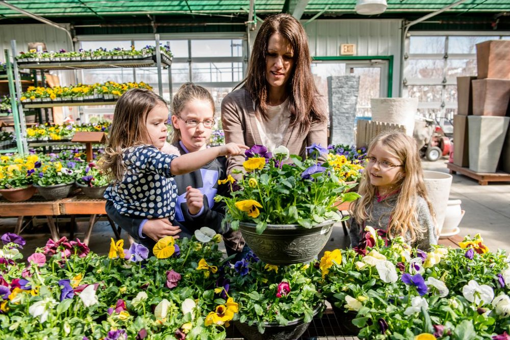 Lynette Streck and her three daughters explore Earl May Nursery & Garden Center.