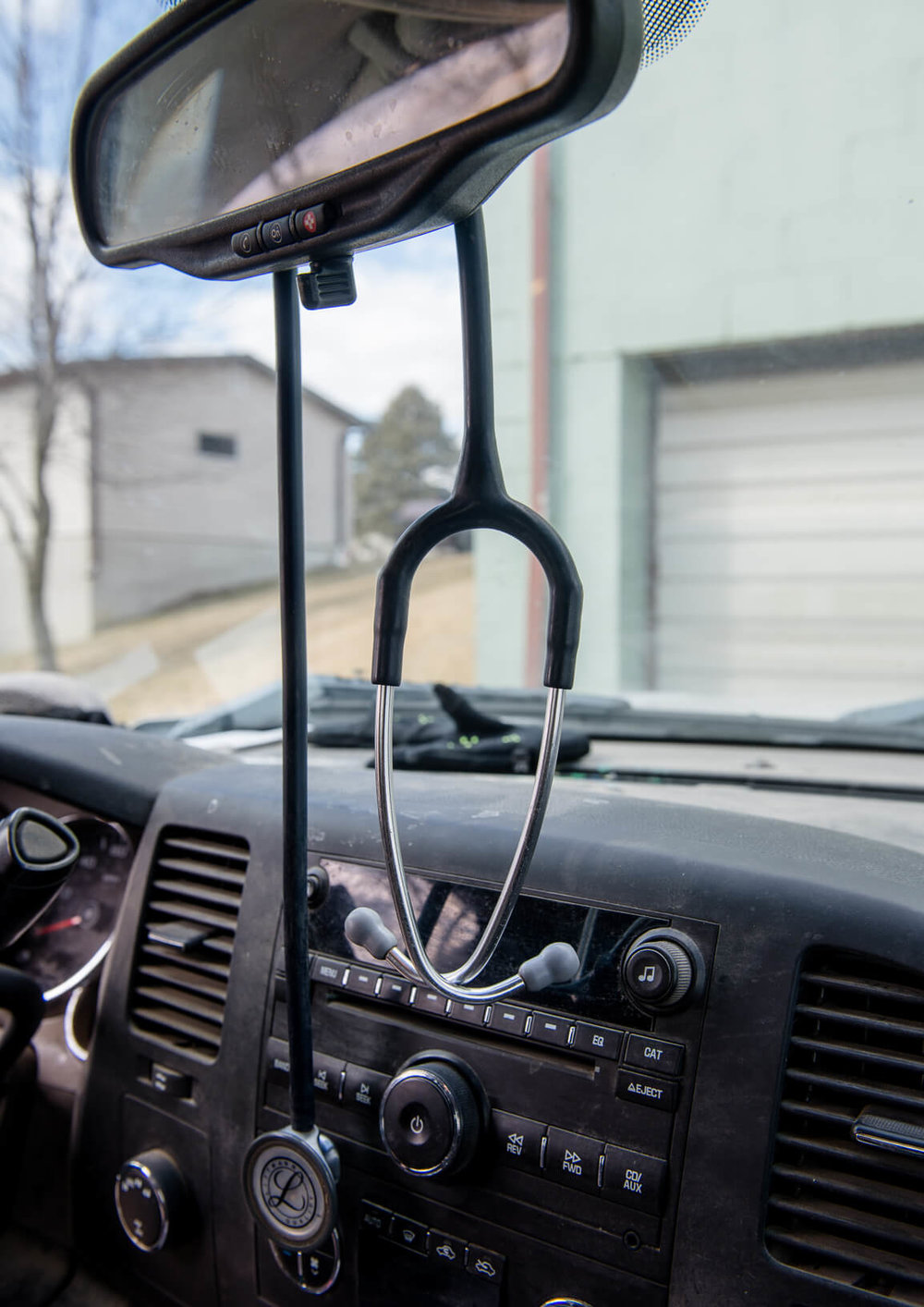 A stethoscope hangs from the mirror of Katie Lang's mobile office.