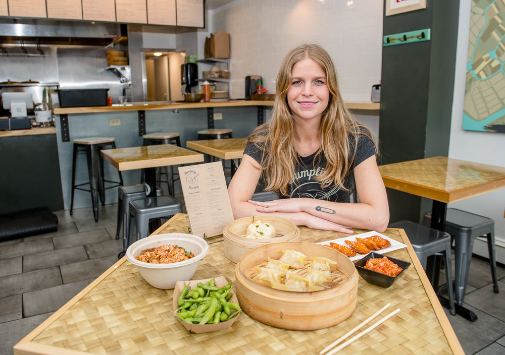 Lesley Triplett sits with a table of freshly made dumplings, bao buns   and   edamame.