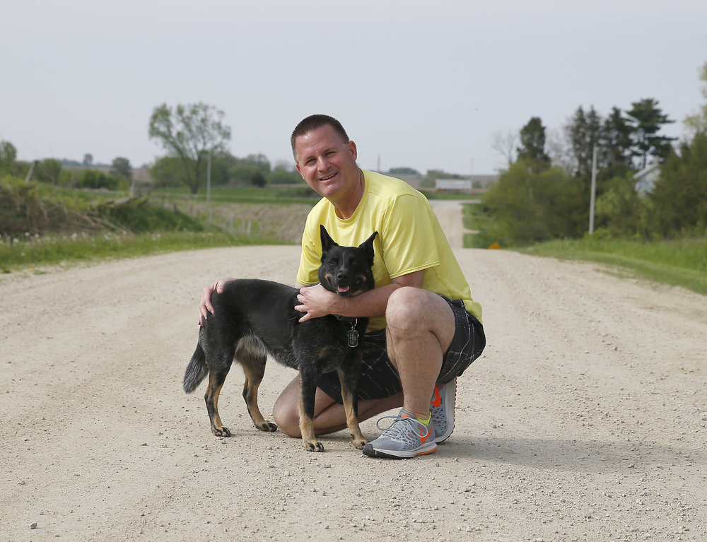 June the Blue Heeler and her owner participate in Live Healthy Iowa Strut Your Pup Challenge.