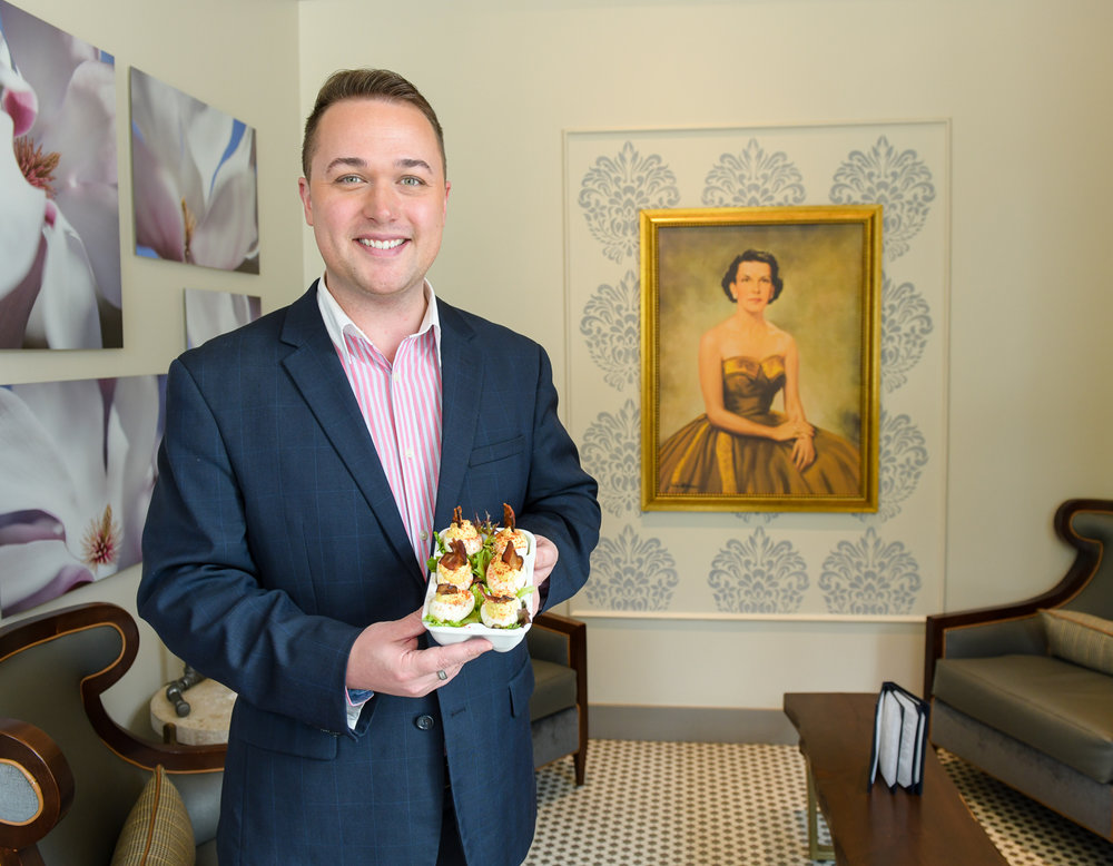 Chris Diebel is the creator and managing partner of Bubba in Des Moines. He stands in front of his grandmother's portrait.