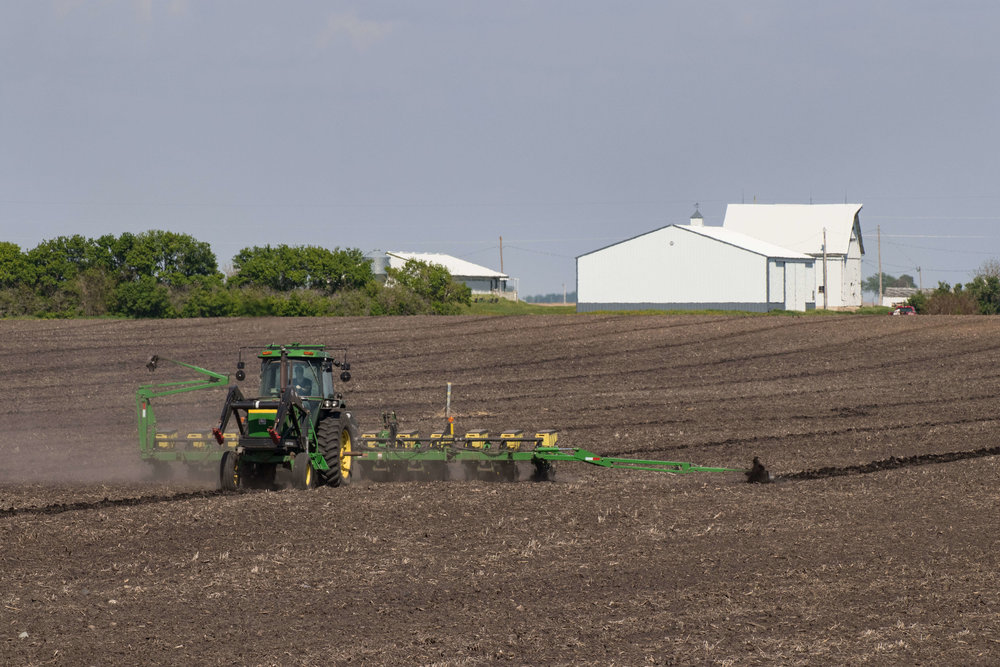 Darcy Maulsby sets the planter to plant soybean seeds 1.5 inches deep, and corn seeds 2 inches deep .