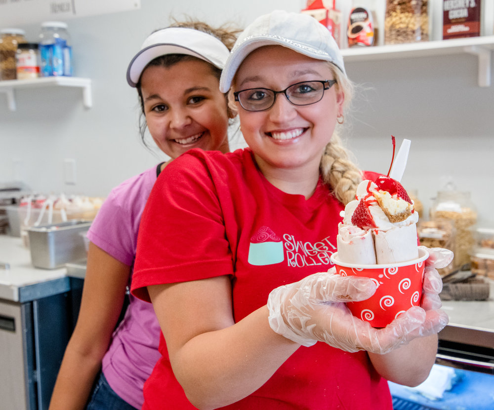 Ryle Defrancisco (left) and Tiera Cordaro show their ice cream creation. Sweet Swirls uses a rolling technique inspired by street food in Thailand. Photo credit: Joseph L. Murphy/Iowa Soybean Association