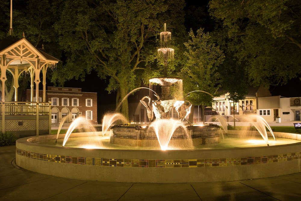 The fountain in Lake City town square is lit for the annual Western Days celebration. Photo credit: Darcy Maulsby.