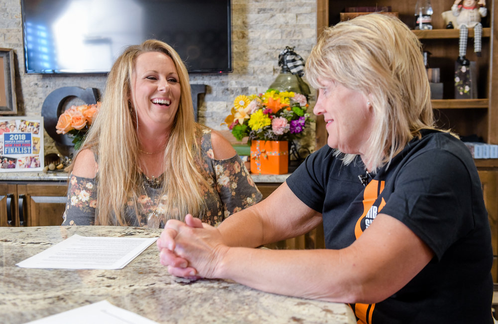 """Joni Bell gives Cristen Clark the inside scoop on the """"All Iowa Belly Up Burger"""" during the podcast. (Photo: Joseph L. Murphy)"""