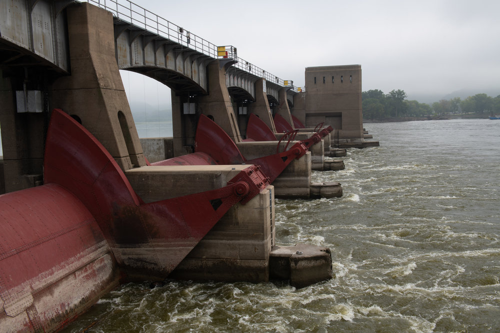 Locks and dams create a series of steps which river tows and other boats either climb or descend as they travel upstream or downstream. Photo credit: Joseph L. Murphy/Iowa Soybean Association