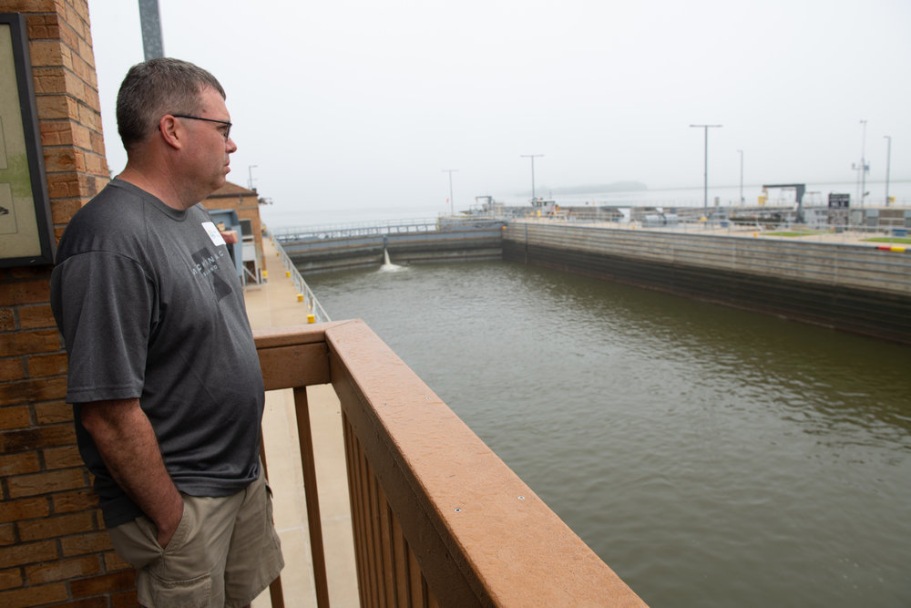 Earl MacLeod stands at Lock and Dam No. 11 during the tour. Photo credit: Joseph L. Murphy/Iowa Soybean Association