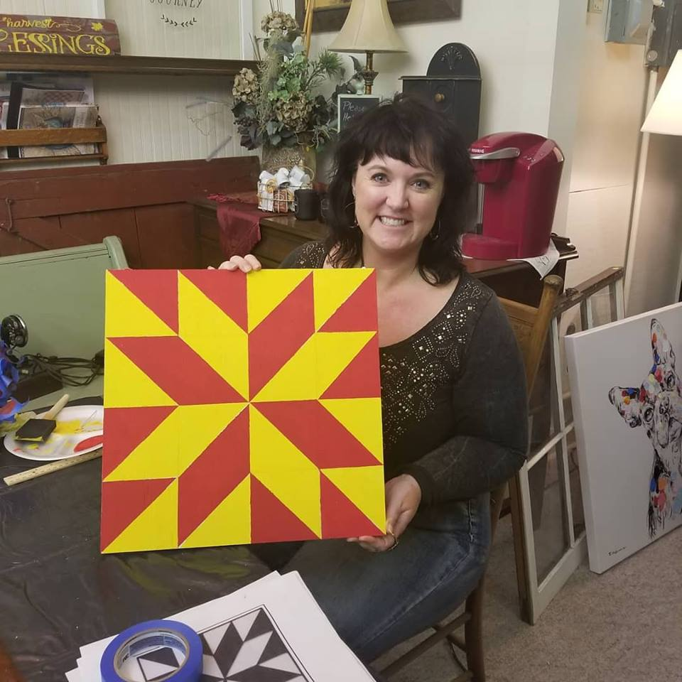 Darcy paints her first barn quilt at the Paisley Pansie custom framing shop in Lake City. Photo credit: Darcy Dougherty Maulsby