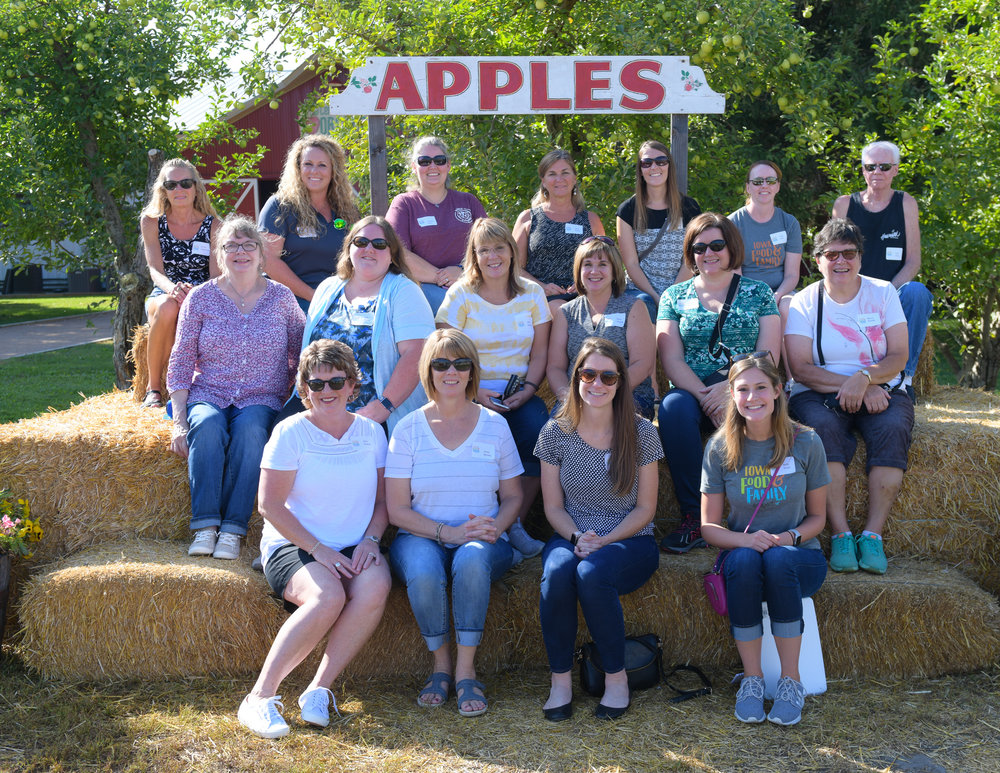 Iowa FFP Champions and their guests stop for a photo outside of Center Grove Orchard in Cambridge. Photo credit: Joseph L. Murphy/Iowa Soybean Association