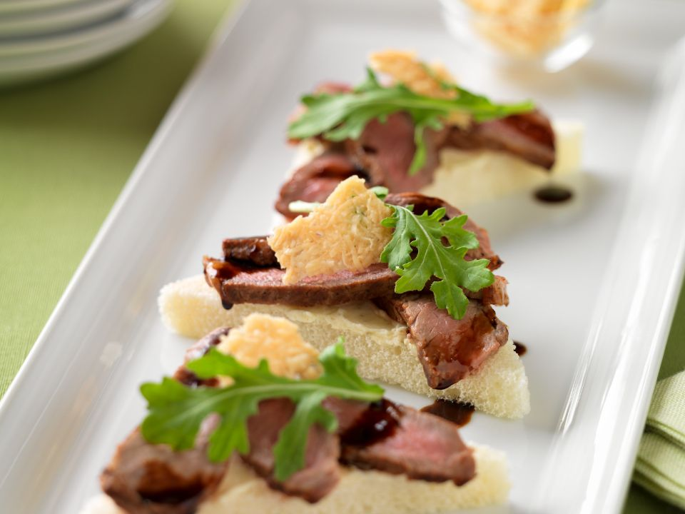 Wet your appetite with Beef Crostini with Parmesan Crisps and Balsamic Drizzle. Photo credit: Iowa Beef Industry Council