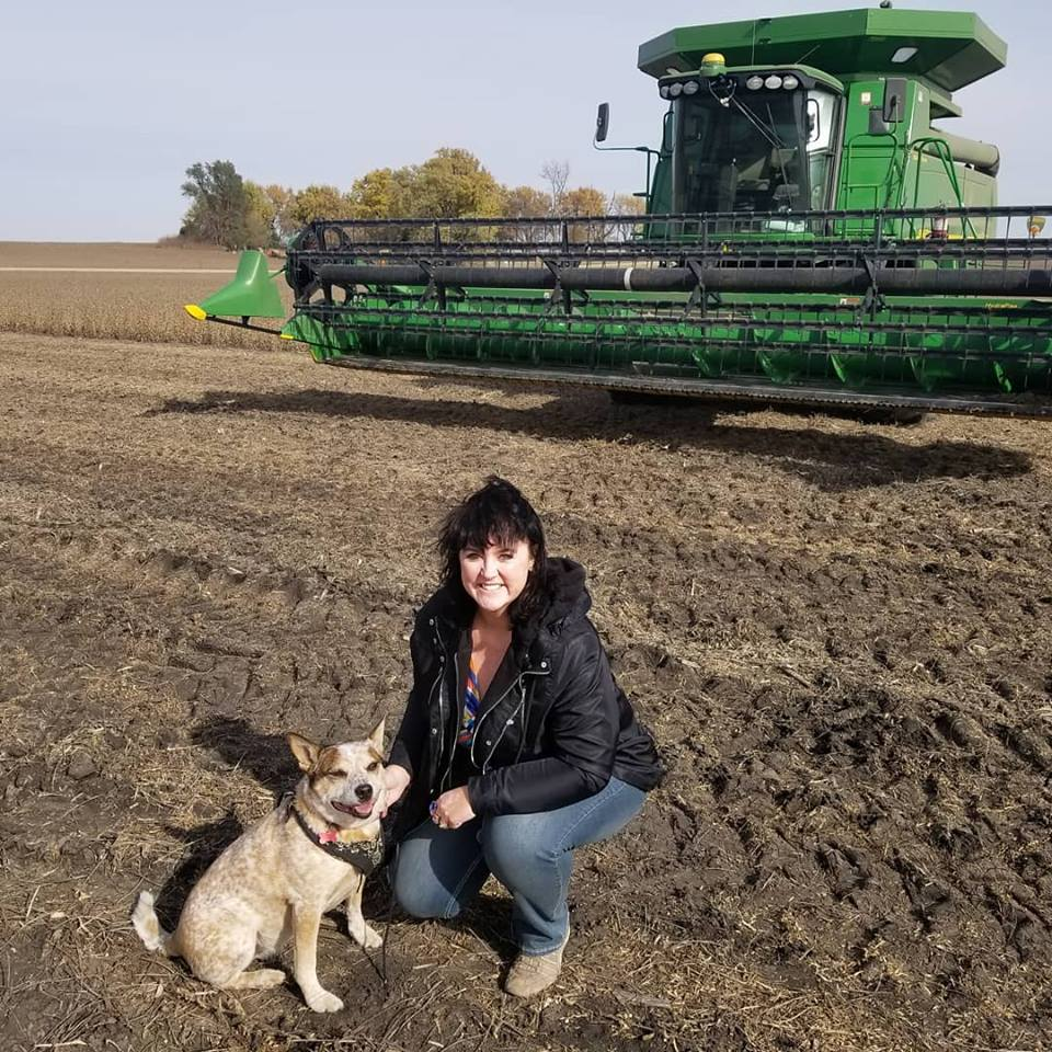 Darcy and Maggie celebrate soybean harvest. Photo credit: Darcy Dougherty Maulsby