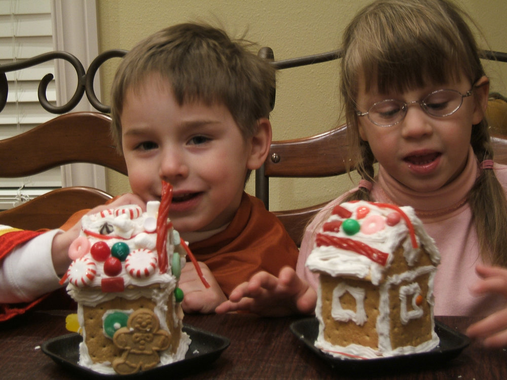 An old family photo of the Latham children with their gingerbread house creations. Photo credit: Shannon Latham