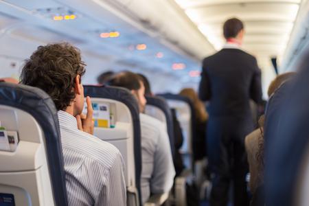 53586633_S_flying_airplane_passengers_man_sitting.jpg