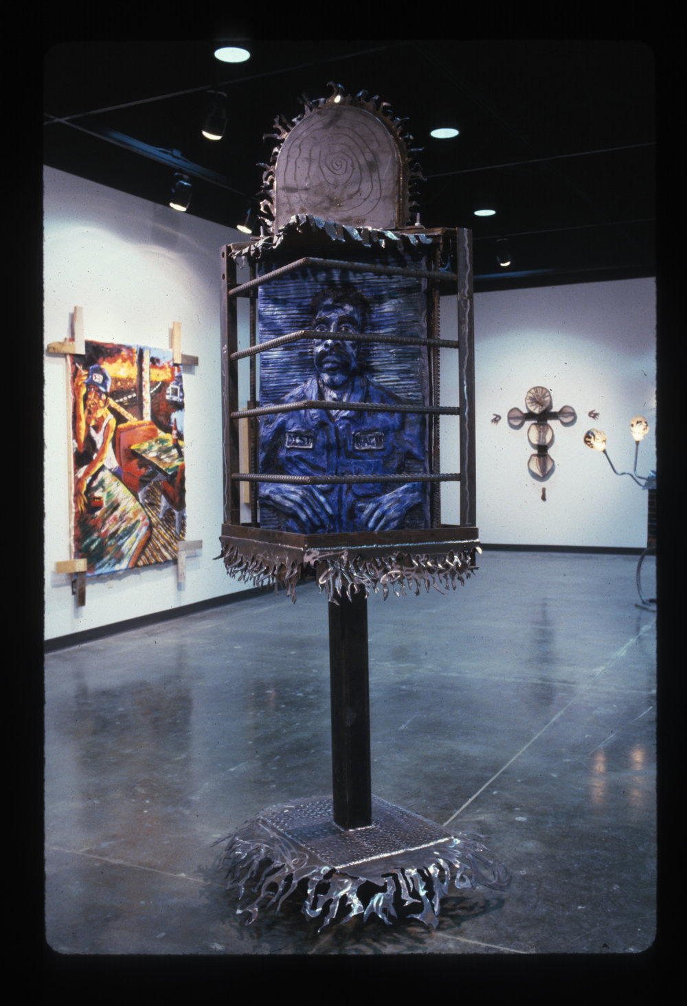 - Distracted and Recycledsteel, plaster paint, saint candle1998