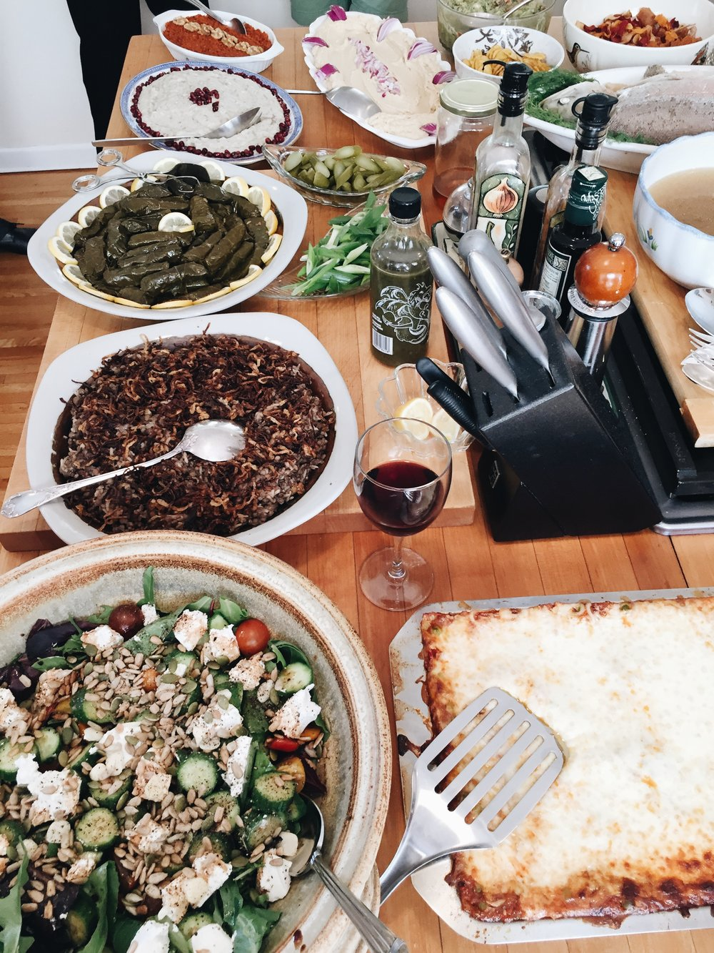 Dad's cooking! Being half-lebanese, we eat a whole variety of dishes on big occasions and celebrations. Grape leaves, lentils, lasagna, hummus, baba ganoush, mixed salad, fish, and a whole lot of other very yummy foods!   Hope to share some of these delicious recipes soon!