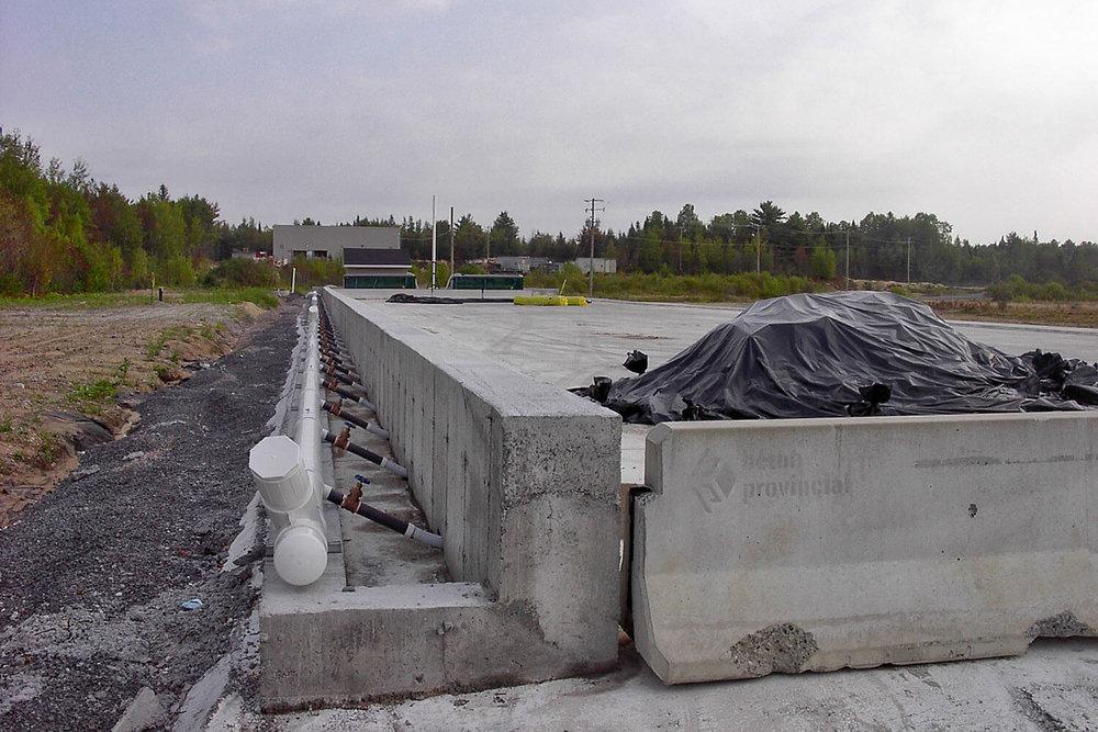 Conception et gestion d'un site de traitement de sols contaminés aux hydrocarbures légers à Neuville