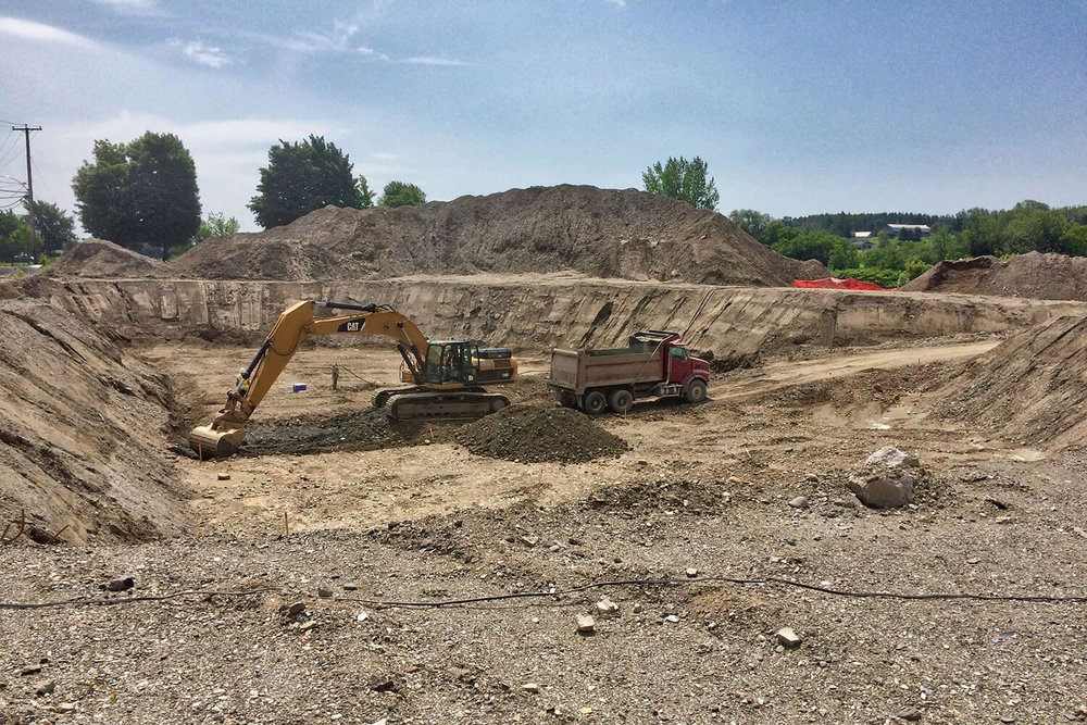 Environmental soil remediation by excavation of industrial site in Sainte-Marie.