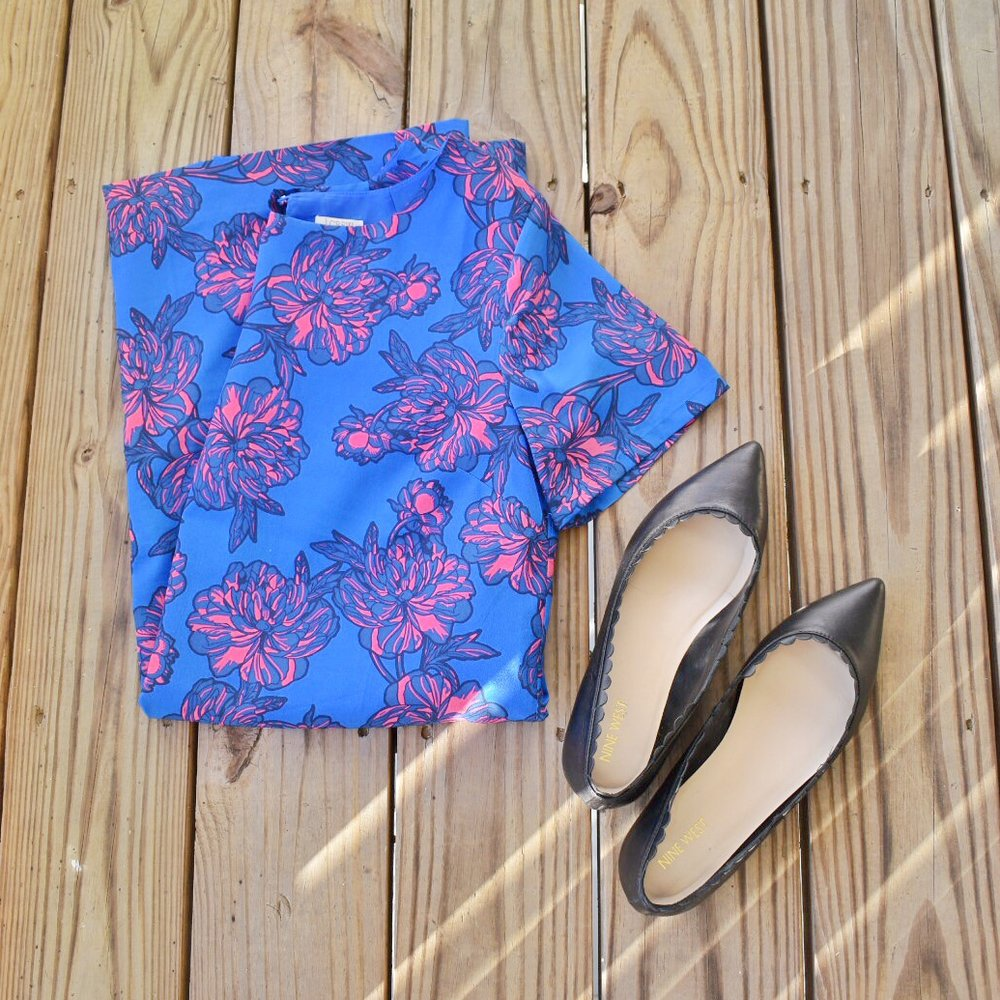 A pink and royal blue floral J.Crew brand shift dress with a pair of black Nine West brand shoes.