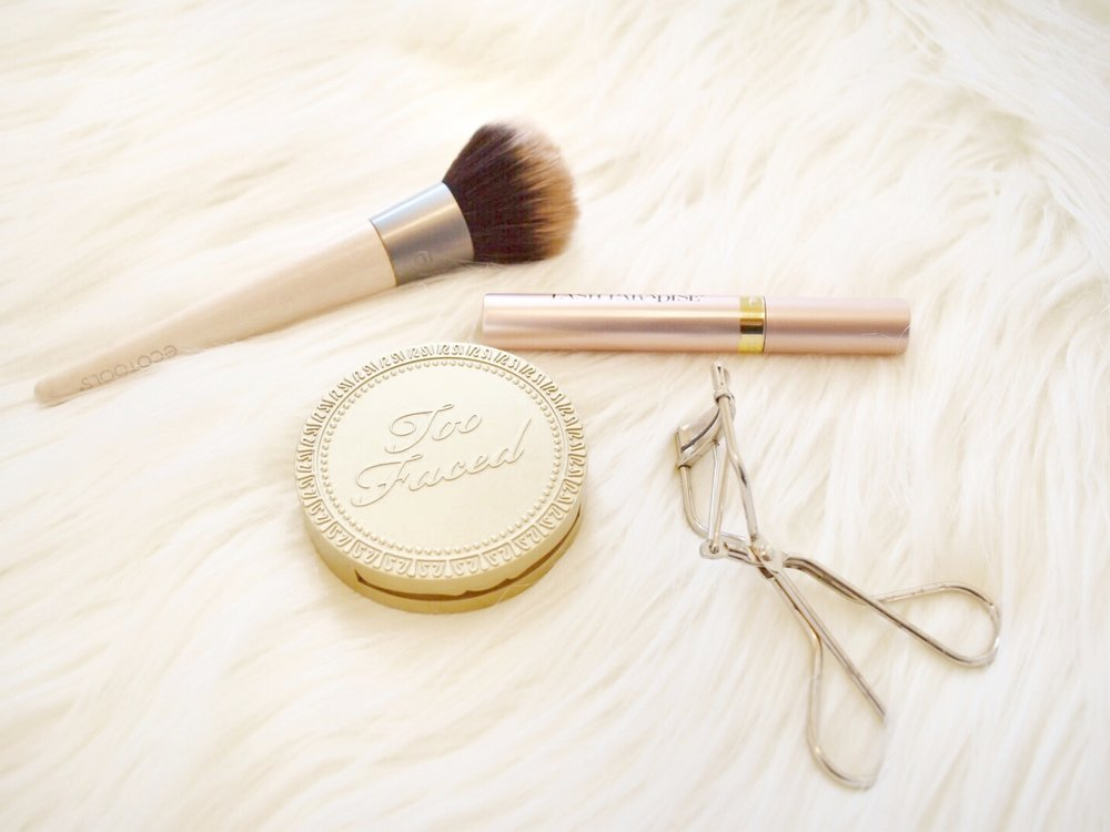 PICTURED:  ECOTOOLS BRUSH ,  TOO FACED CHOCOLATE SOLEIL BRONZER ,  LOREAL LASH PARADISE MASCARA ,  EYELASH CURLER