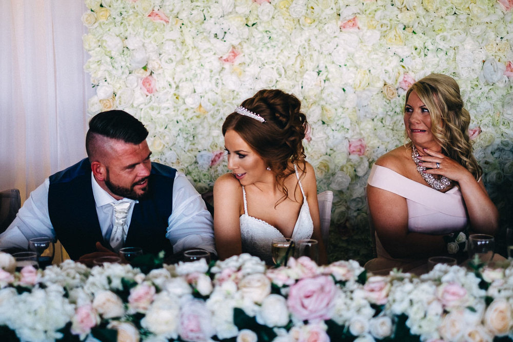 Candid moment of bride, groom and mother of the bride at a relaxed wedding in Celtic Manor Newport South Wales