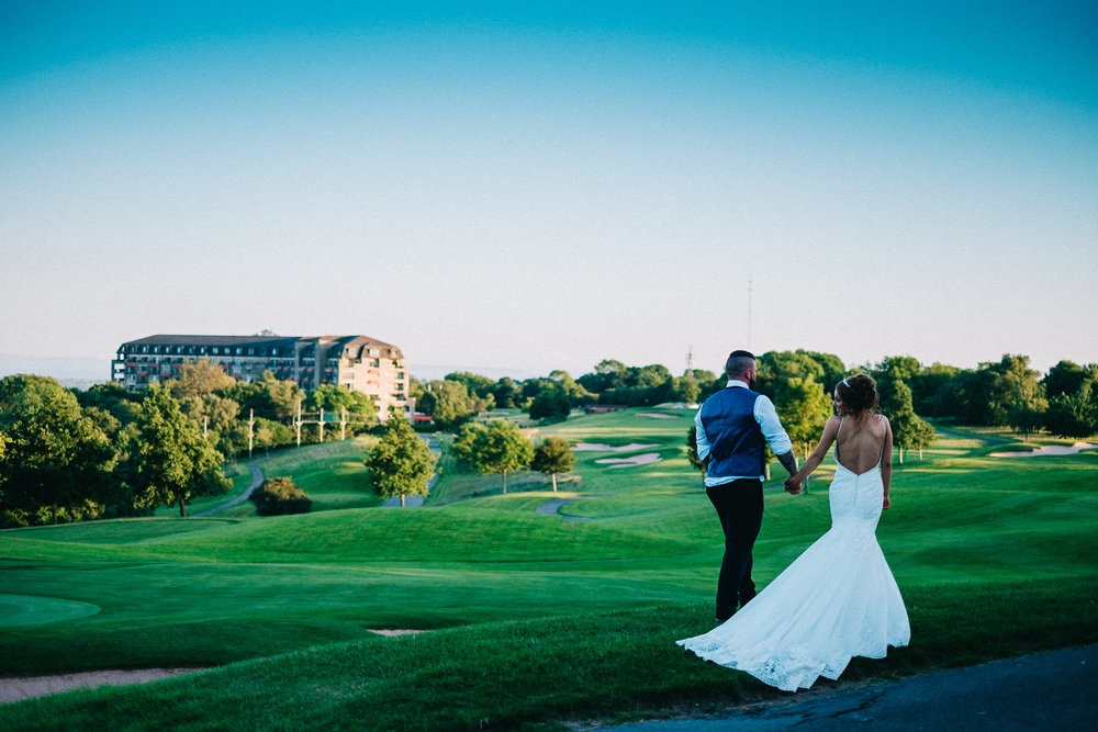 Bride and groom overlooking Celtic Manor at relaxed wedding in Newport for South Wales Wedding Photographer