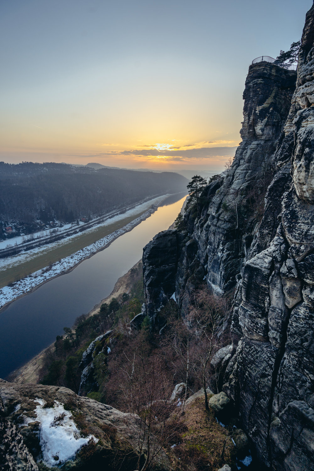 The sun sets in the distance, Saxon Switzerland