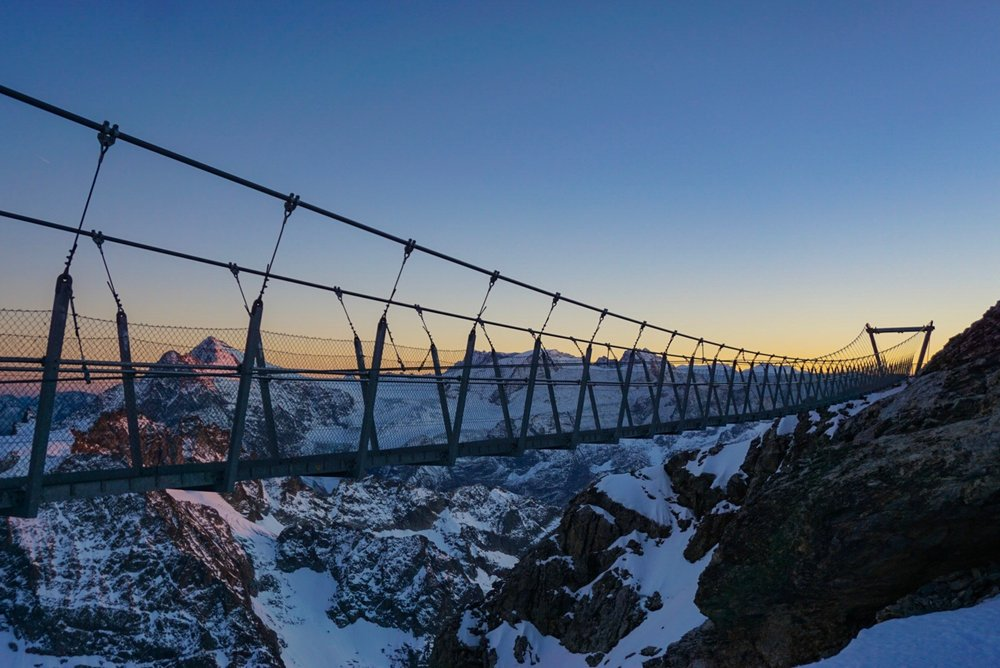 Suspension bridge on Mt Titlis overlooking the Alps