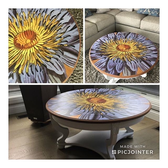 "Price reduced on our one-of-a-kind Periwinkle Burst Coffee Table! This wooden table was completely stripped and lovingly revived with artwork applied directly to the top. The white curved legs and decorative shelf were hand painted white. 35"" in diameter. $325 #vavabode #upcycled #naturalcuriosities"