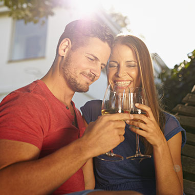 stock-photo-outdoor-shot-of-young-caucasian-couple-in-backyard-toasting-wine-smiling-romantic-couple-relaxing-283236521.jpg