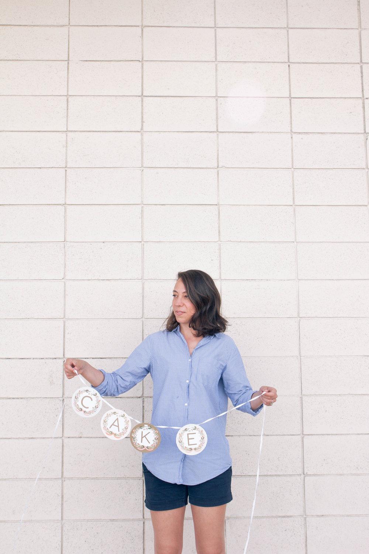Celia holding cake banner
