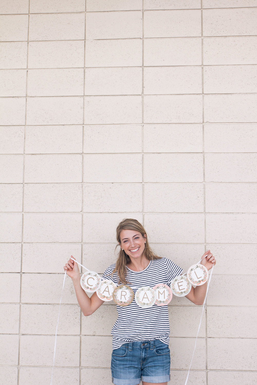 Courtney holding caramel banner