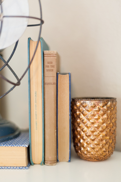 candle with vintage books, vintage home decor, farmhouse decor