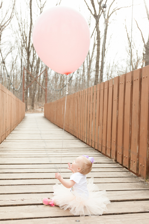 This is the winning shot right here, she's looking up at that big pink balloon!