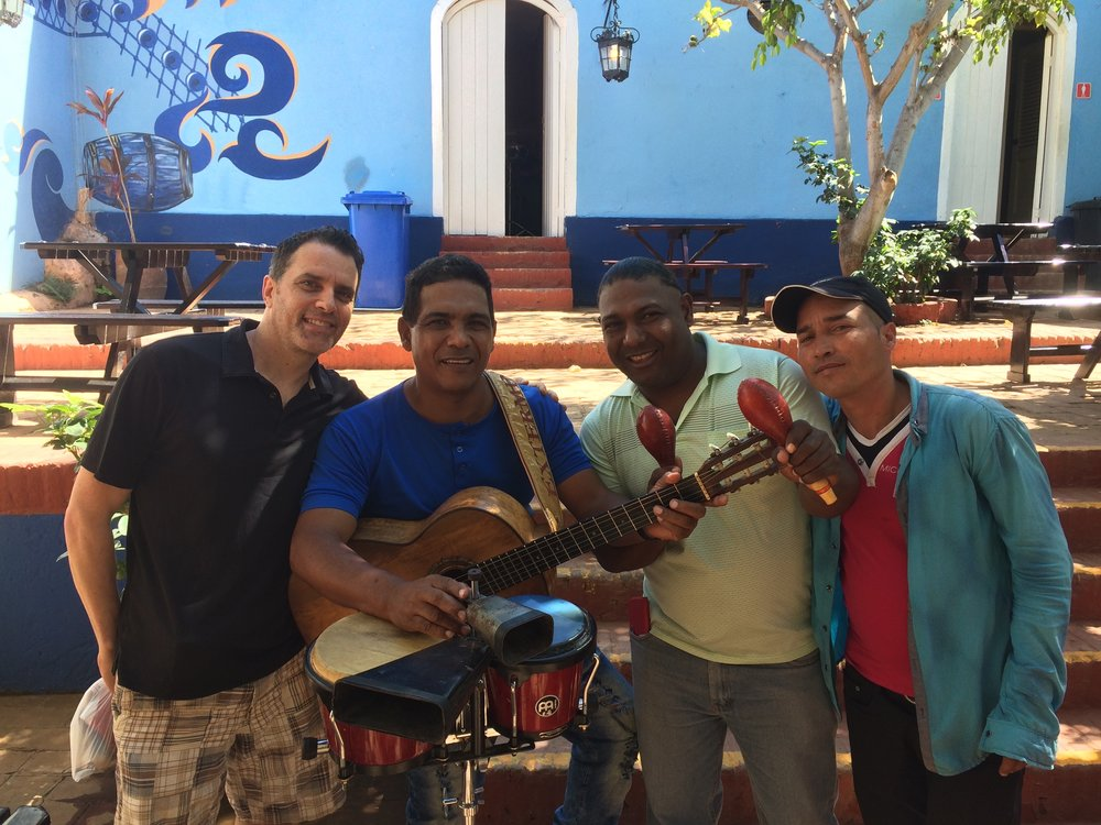 Raúl and his brother in Trinidad de Cuba flanked by their bass player (right) and a grateful goumba (left)