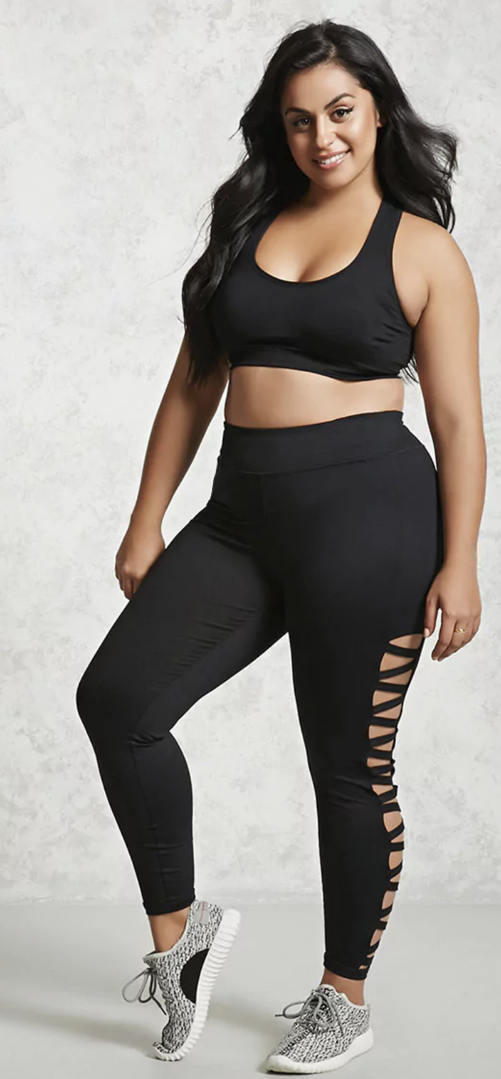 Forever 21+   - A pair of athletic leggings featuring strappy cutout sides, a hidden key pocket, moisture management, and a back reflective logo.