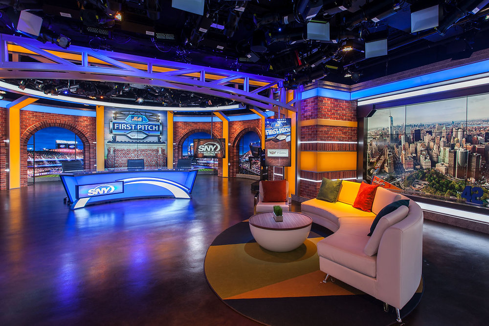 "SNY Studios, major fabrication including brick work, ""steel girder"" window frames, LED lightbox wall toppers."