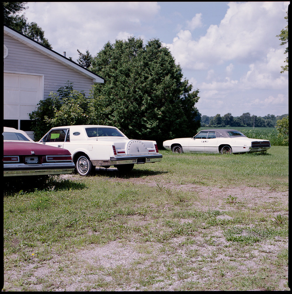 Kodak-Portra-160-Hasselblad-501CM-6x6-Chatam-Ontario-Vintage-Car-Parking-Lot-on-Grass.jpg