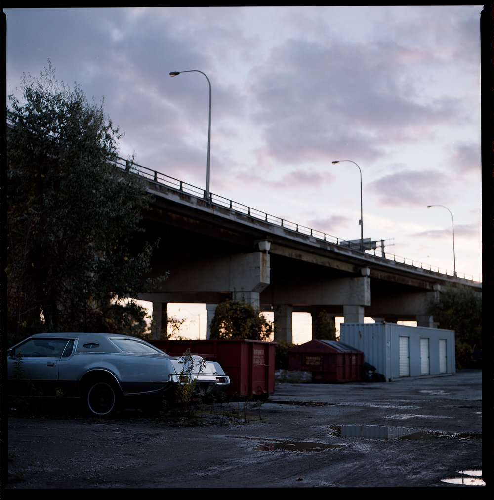 Kodak-Portra-160-Fall-Sunset-Downtown-Toronto-Vintage-Sombre-Lonely-Color-Pallette-Pushed-Pulled-Hasselblad_Sunset-Light-Lonely-Car-Purple-Clouds-Alt.jpg