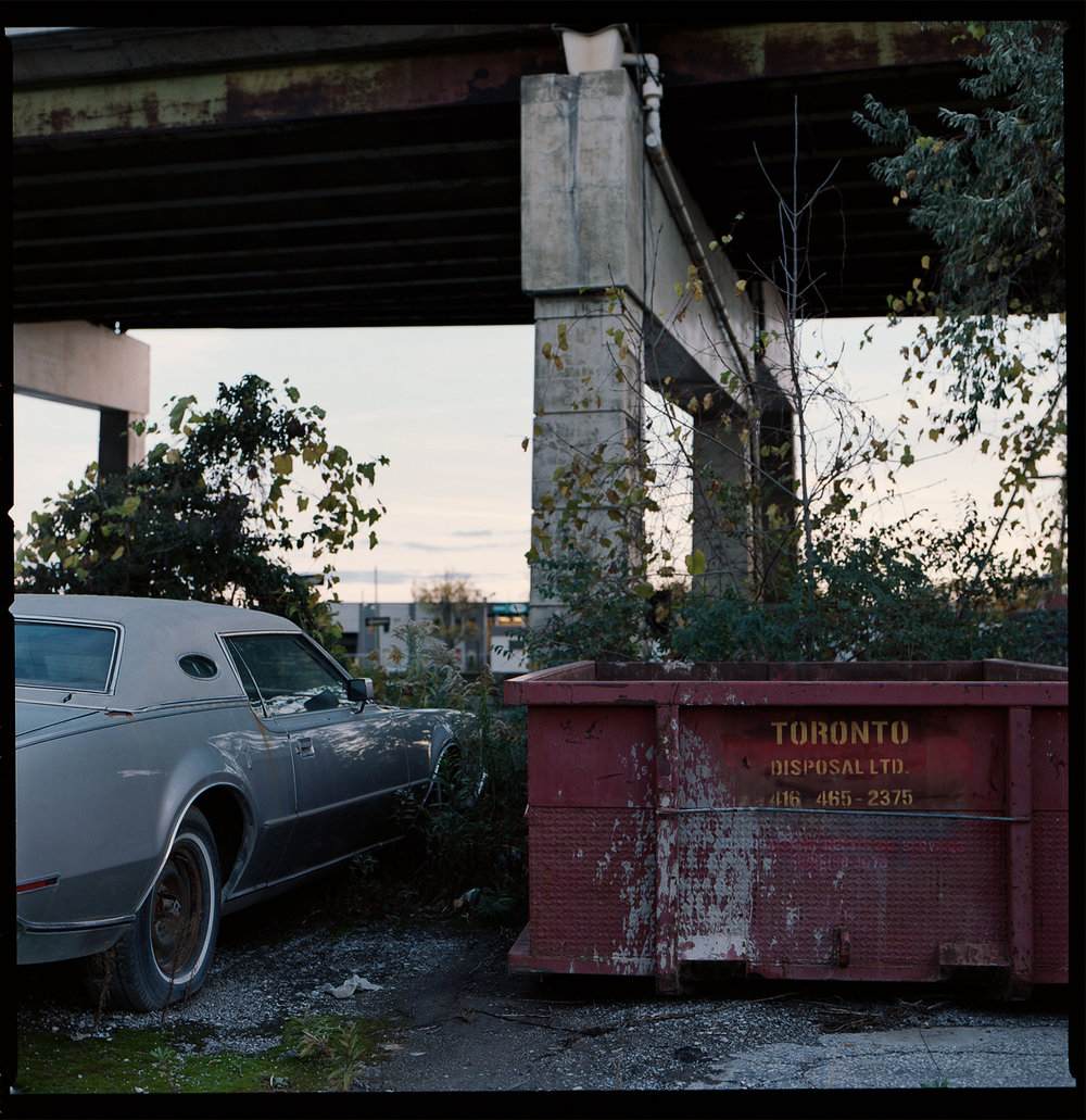Kodak-Portra-160-Fall-Sunset-Downtown-Toronto-Vintage-Sombre-Lonely-Color-Pallette-Pushed-Pulled-Hasselblad_Sunset-Light-Lonely-Car-Details.jpg