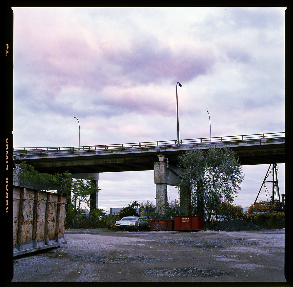 Kodak-E100GX-Long-Exposure-Junkyard-downtown-toronto-Hasselblad-Pink-Sunset-Purple-Sky-Clouds-Skyline-Vintage-Car.jpg