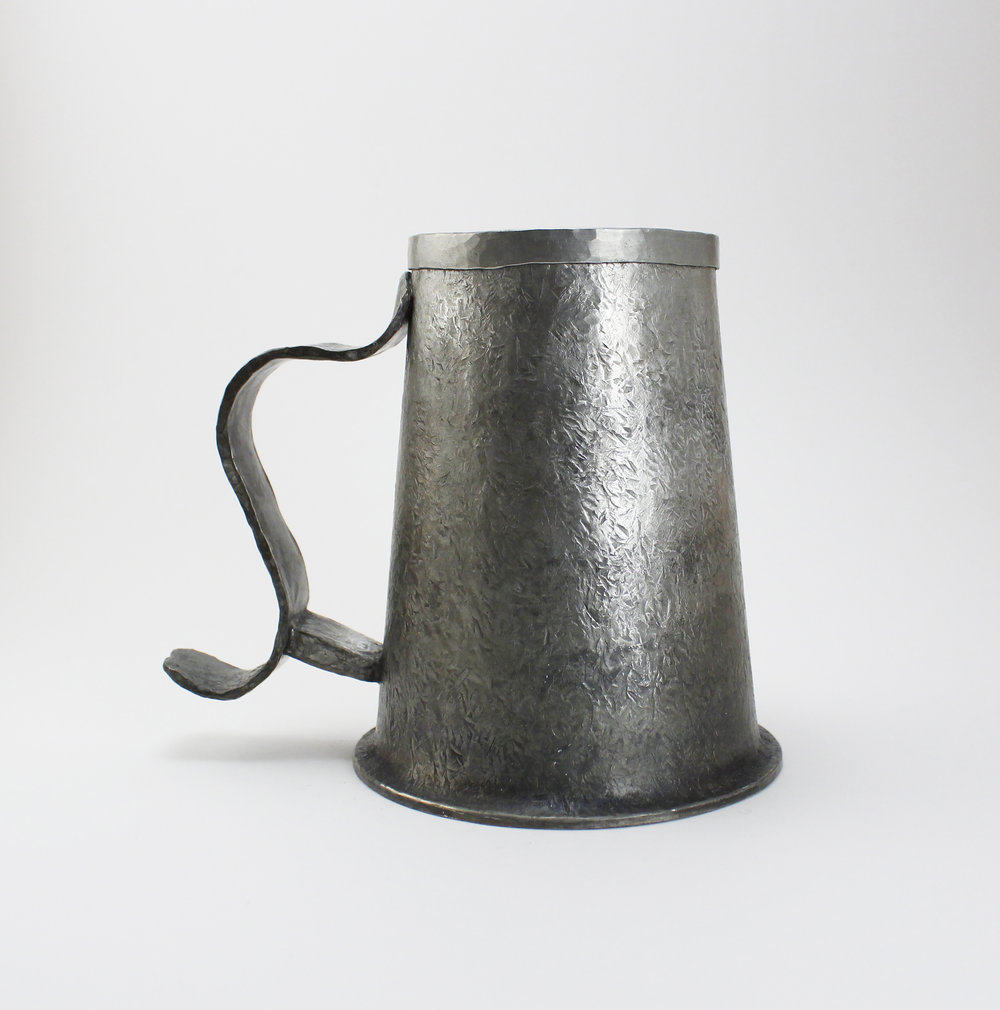 Beer Tankard (Front)    Pewter  5 1/2'' x 4'' x 5''  14.5cm x 10cm x 12cm  2015