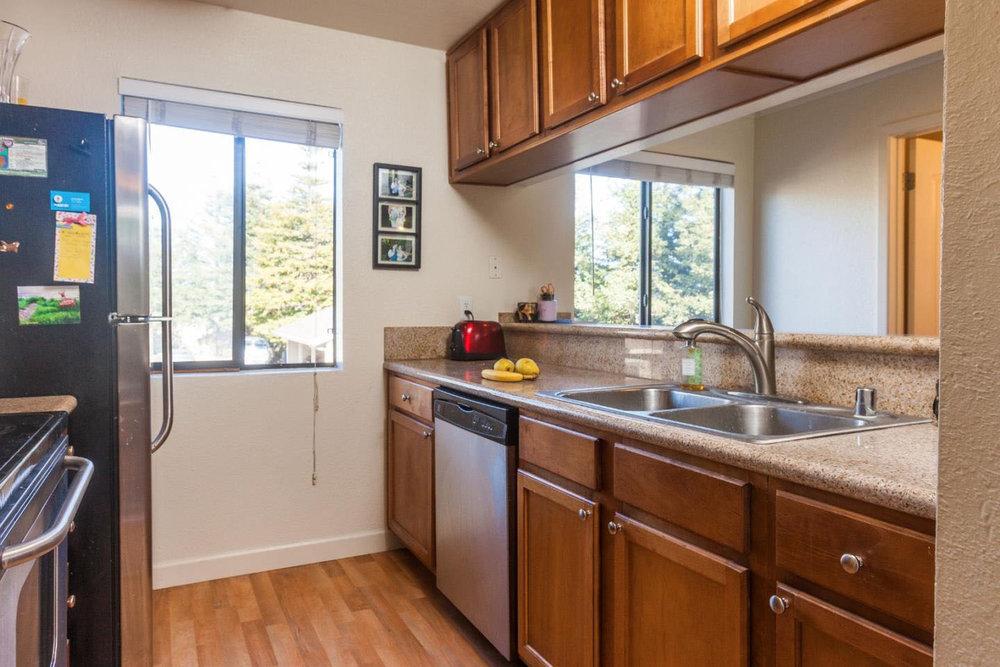 Real Estate Agents In Santa Cruz Turnkey Condo Laundry Room & FP